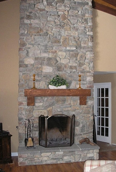 Rustic Eldorado Stone veneer fireplace - Click here for larger view