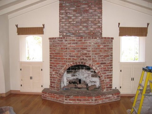 massive floor to ceiling brick fireplace raised brick hearth and brick mantel - Brick Fireplace