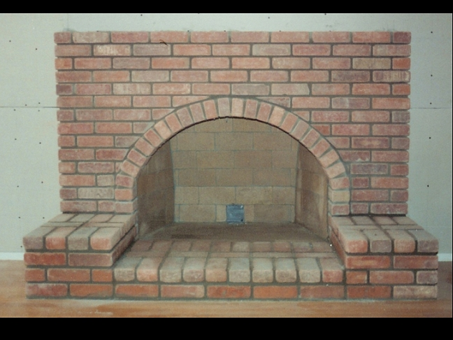 Brick Fireplace Part - 49: Brick Fireplace With Arch And Raised Hearth
